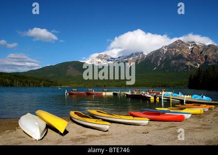 Canoes kayaks on shore in Pyramid lake in Jasper national park, Alberta, Canada - Stock Photo