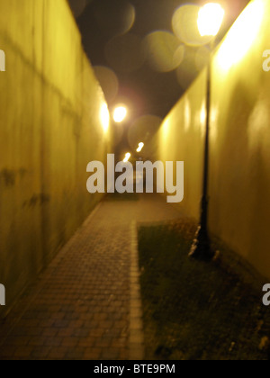 Empty alleyway at night - Stock Photo