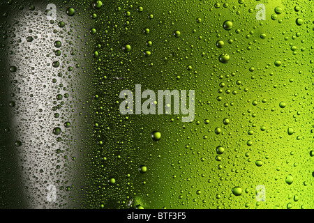Texture water drops on the bottle of beer. - Stock Photo