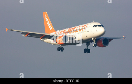 An Easyjet aircraft comes in to land at London's Gatwick Airports. Picture by James Boardman - Stock Photo