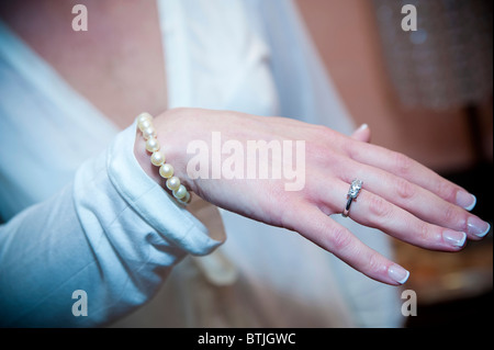 Woman showing her ring - Stock Photo