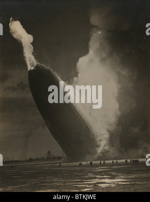 The Hindenburg hits the ground in flames in Lakehurst, N.J. on May 6, 1937. - Stock Photo