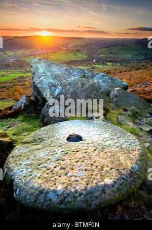 Abandoned Millstone at Sunset on Curbar Edge, Peak District National Park, Derbyshire, England, UK - Stock Photo