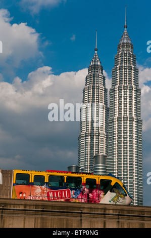 KL Monorail with Petronas Towers in the background, Kuala Lumpur, Malaysia - Stock Photo