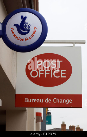 a bureau de change sign advertising the present exchange rate outside stock photo royalty free. Black Bedroom Furniture Sets. Home Design Ideas