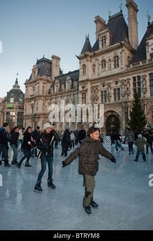 Teenagers Ice Skaters on Ice Skating Rink at Paris City Hall Building, H-tel de Ville, Paris, France - Stock Photo