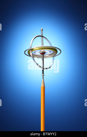 A spinning metal gyroscope on the tip of a sharpened yellow pencil. - Stock Photo