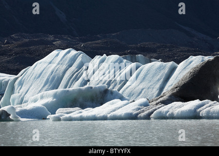 Icebergs in Tasman Glacier Terminal Lake, Aoraki / Mt Cook National Park, Canterbury, South Island, New Zealand - Stock Photo