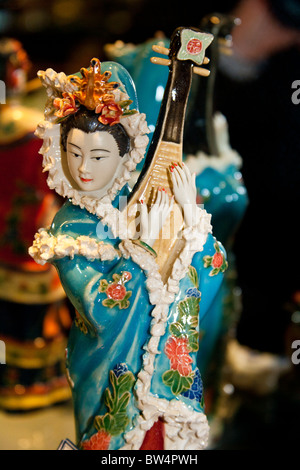Painted jade carving of a Chinese woman playing a musical instrument, Beijing, China - Stock Photo