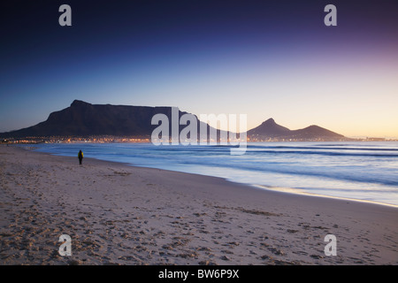 View of Table Mountain at sunset from Milnerton beach, Cape Town, Western Cape, South Africa - Stock Photo