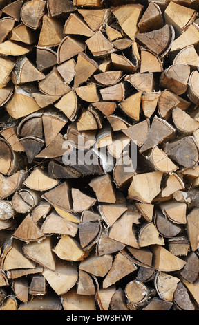 Background - the Stack of fire wood from birch logs - Stock Photo
