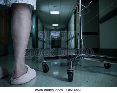 Female patient with intravenous drip - Stock Photo