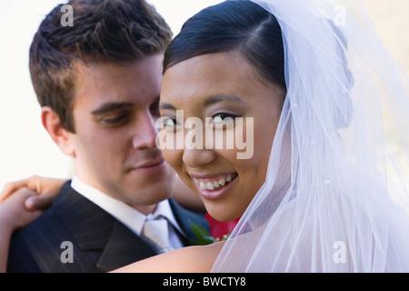 USA, Illinois, Metamora, Portrait of bride and groom - Stock Photo
