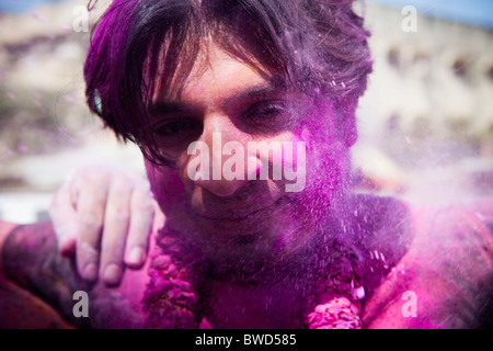 Coloured powder on faces, Festival of Holi. - Stock Photo