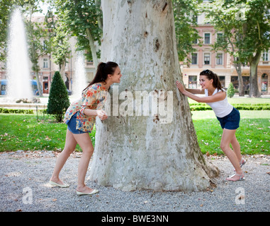 Young women playing hide and seek - Stock Photo