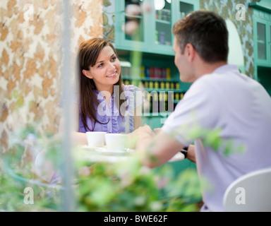 Couple in cafÈ store - Stock Photo
