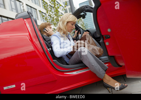 Couple in an electric sports car - Stock Photo