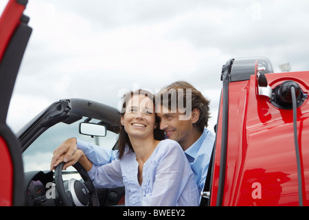 Couple close together in an electric car - Stock Photo