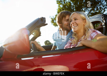 Couple sitting in their electric car - Stock Photo