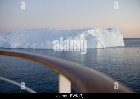 Railing of cruise ship MS Deutschland and icebergs from Ilulissat Kangerlua Icefjord at dusk, Ilulissat (Jakobshavn), - Stock Photo