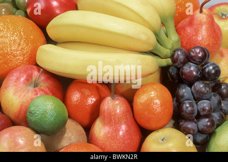 Various fruit: Bananas, Grapes, Apples, Pears, Clementines, Oranges and Limes. - Stock Photo