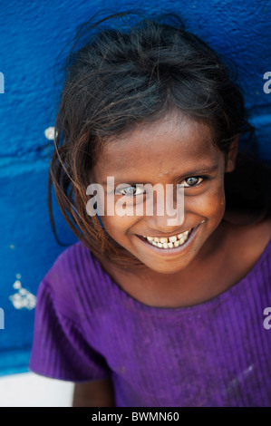 Happy young poor lower caste Indian street girl smiling. Andhra Pradesh, India. Selective focus - Stock Photo