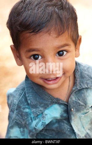 Smiling happy Indian village boy. Andhra Pradesh, India. Selective focus - Stock Photo