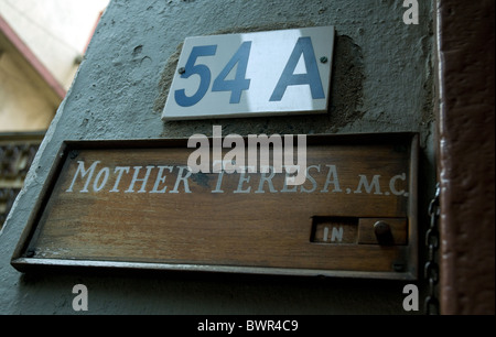 Door panel to the Kolkata building housing Mother Teresa's tomb.  To Mission  nuns and to visitors she is 'in' - Stock Photo