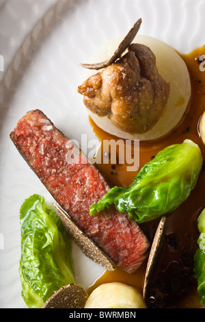 Danish Beef with Celery, Small Cabbages, Sweetbreads and Black Truffles prepared by Kristian Meller and Rune Jochumsenat, - Stock Photo