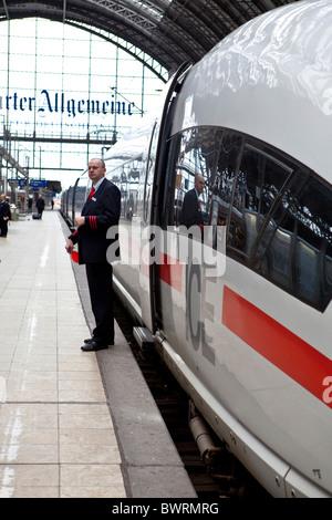 A Deutsche Bahn employee standing in front of an ICE, Frankfurt Central Station, Frankfurt am Main, Hesse, Germany, - Stock Photo