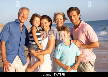 Portrait, Three Generation Family On Beach Holiday - Stock Photo