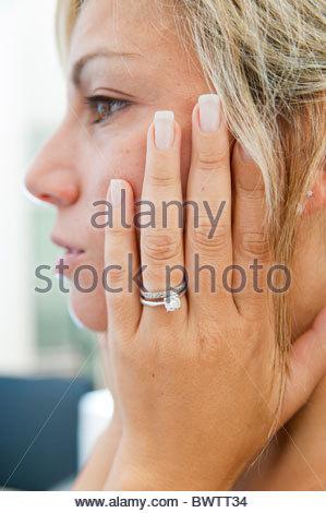Woman wearing engagement ring - Stock Photo