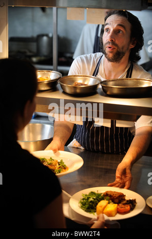 Head Chef Stephen Terry Applies Finishing Touches To Meals