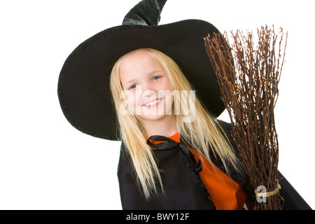 Portrait of girl in witch costume looking at camera - Stock Photo