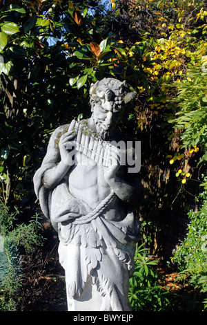 Stone Garden Statue Of Pan Playing His Pipes Stock Photo