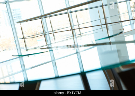 Image of banisters and windows in office building - Stock Photo