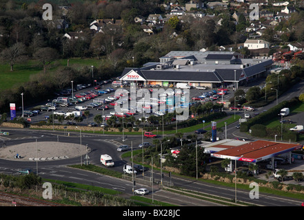 Aerial view of edge of town Tesco Superstore and Petrol station and A30 roundabout Penzance Cornwall UK - Stock Photo