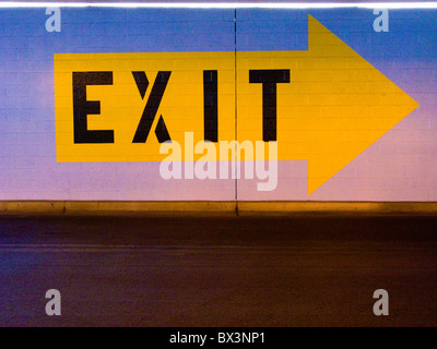 Exit sign in parking garage - Stock Photo
