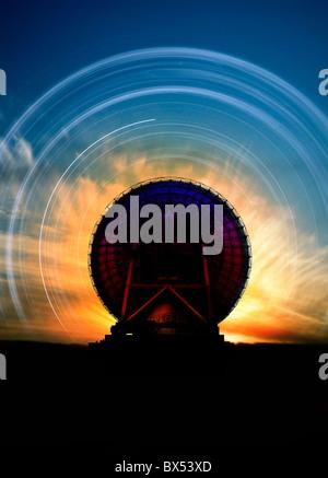 Radio telescope and star trails, artwork - Stock Photo