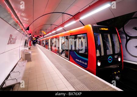 A Docklands Light Railway DLR train at Bank Station, London, England, UK - Stock Photo