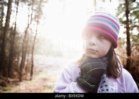 Cute Young Girl in Winter Clothes in the Forest - Stock Photo
