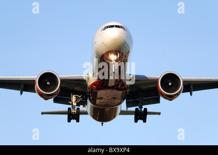 Boeing 777 operated by Air India on final approach for landing at London Heathrow Airport - Stock Photo