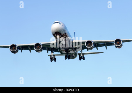 Airbus A340 operated by Arik Air on approach for landing at London Heathrow Airport - Stock Photo