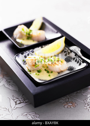 Close-up of scallop with lime slice - Stock Photo