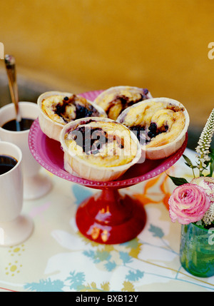 Cinnamon buns on cake stand - Stock Photo
