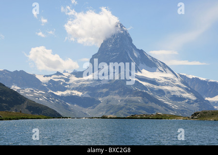 View at the ''smoking'' Matterhorn mountain from the lake side - Stock Photo