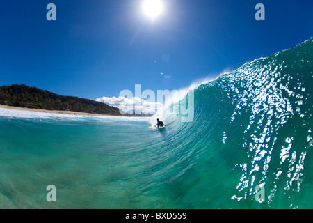 A water view of a surfer getting barreled at Pupukea Sandbar. - Stock Photo