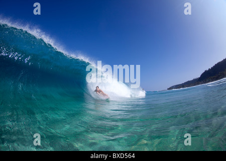 A water view of a surfer girl in the tube, in Hawaii. - Stock Photo