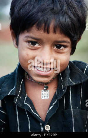 Young poor lower caste Indian street boy smiling. Andhra Pradesh, India - Stock Photo
