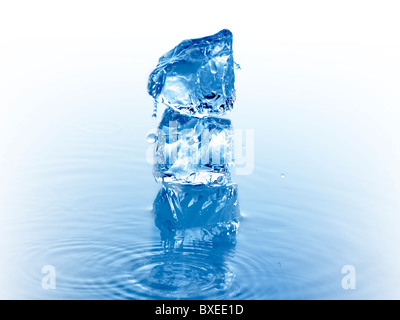 Stack of ice cubes in water - Stock Photo